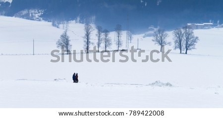 TYROL, AUSTRIA - CIRCA 2017: Two men walks in the snow at winter circa 2017 in Tyrol.