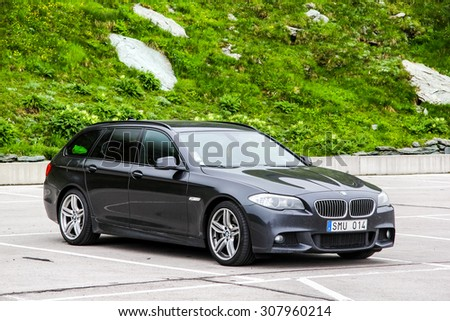 TYROL, AUSTRIA - JULY 29, 2014: Motor car BMW F11 5-series at the Grossglockner High Alpine road. - stock photo