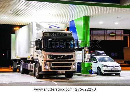 TYROL, AUSTRIA - JULY 28, 2014: White cargo truck Volvo FM at the gas station. - stock photo