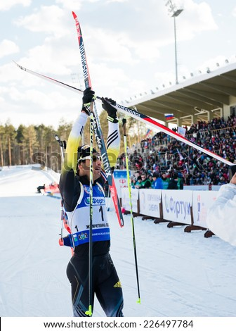 "Tyumen, RUSSIA - APR 9, 2014: Martin Fourcade (FRA) after finish at Biathlon Men's 18 km Mega Mass start at International Biathlon Competition ""Award from the Governor of the Tyumen region  - stock photo"