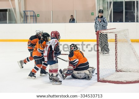 Tyumen, Russia - April 14, 2013: Hockey tournament on prize of name A.P.Vahrin among teams of children till 9 years old. Attack of gate in game between Spartakovets 04-Ekaterinburg and Molot 04-Perm