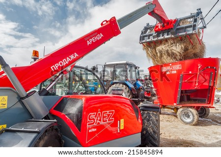 "Tyumen, Russia - April 04. 2014: IV Tyumen specialized exhibition ""Agricultural Machinery and Equipment"". Agricultural wheel loader demonstration - stock photo"