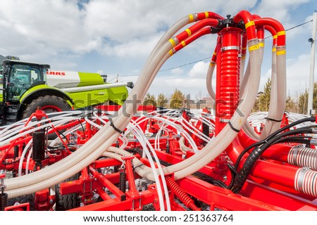 "Tyumen, Russia - April 04. 2014: IV Tyumen specialized exhibition ""Agricultural Machinery and Equipment"". Additional equipment for tractor demonstration - stock photo"