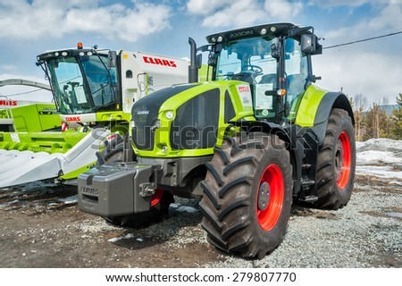 "Tyumen, Russia - April 04. 2014: IV Tyumen specialized exhibition ""Agricultural Machinery and Equipment"". Tractor demonstration on platform open-air - stock photo"