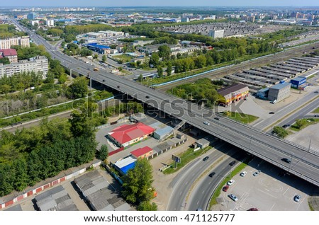 Tyumen, Russia - August 9, 2016: Aerial view on city quarters. Permyakova street. Bridge intersection with railways