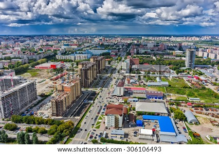 Tyumen, Russia - August 13, 2015: Aerial view onto Magnet hypermarket, Central and Novin residential district construction  and office buildings on Harkovskaya street