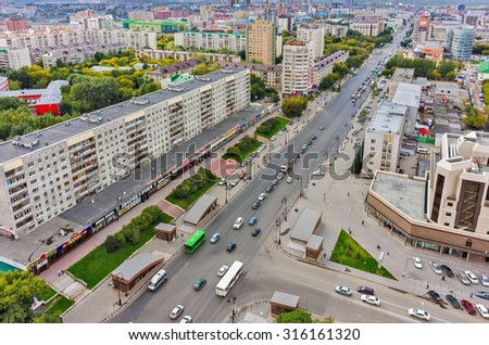 Tyumen, Russia - August 25, 2015: Aerial view onto Respubliki and Maxima Gorkogo streets Intersection and quarters view - stock photo