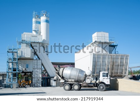 Tyumen, Russia - August 13, 2013: Finished goods warehouse at Concrete Goods Plant No. 5. Agitating lorry faces solution and concrete node - stock photo