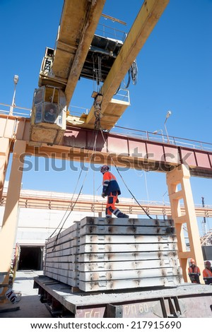 Construction Crew Working On Roof Sheeting Stock Photo