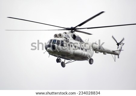"Tyumen, Russia - July 30, 2006: Air show ""On a visit at UTair"" in heliport Plehanovo. Flying helicopter MI-8 with coloring of the UN - stock photo"