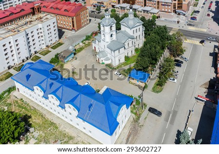 Tyumen, Russia - June 27, 2015: View at city quarters with Archangel Michael Church