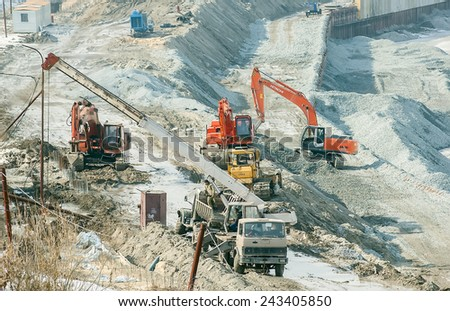 Tyumen, Russia - March 29, 2008: Construction of pedestrian quay on Tura river in Tyumen - stock photo