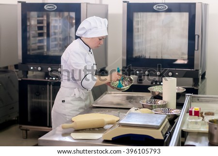 Tyumen, Russia - March 23. 2016: Open championship of professional skill among youth. World skills Russia Tyumen - 2016. Girl-cook prepares food in competition of masters of cook business