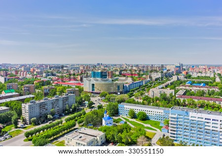 Tyumen, Russia - May 25, 2015: Bird eye view onto Tyumen oil and gas university, 50 Let Oktyabrya street, Church in honor of Healer Mother of God icon and regional clinical hospital No. 2 - stock photo