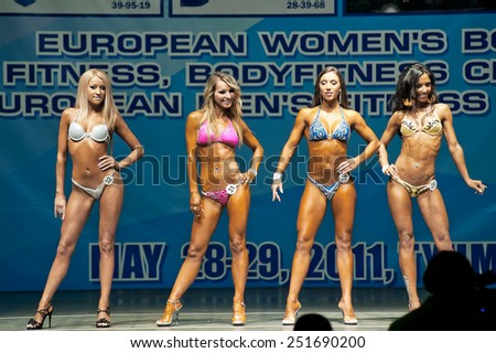 Tyumen, Russia - May 28, 2011: European Women Bodybuilding, Fitness, Bodyfitness, Bikini and Men Fitness Championships. Morning session - stock photo
