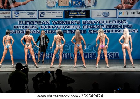 Tyumen, Russia - May 28, 2011: European Women Bodybuilding, Fitness, Bodyfitness, Bikini and Men Fitness Championships. Prejudging - Morning session. Back view - stock photo