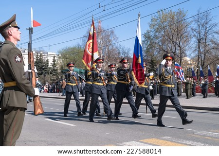 Tyumen, Russia - May 9. 2009: Parade of Victory Day in Tyumen. Banner group of police on parade