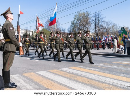 Tyumen, Russia - May 9. 2009: Parade of Victory Day in Tyumen. Banner group of russian army division on parade