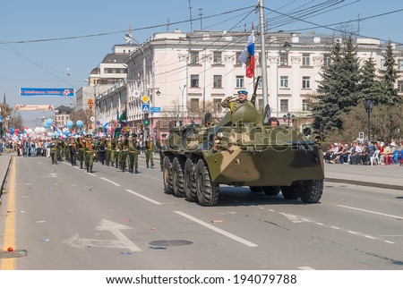 Tyumen, Russia - May 9. 2009: Parade of Victory Day in Tyumen. Officer on armored personnel carrier and guard of honor on parade - stock photo