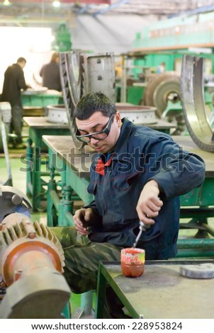 Tyumen, Russia - November 14, 2007: JSC Tyumenskie Motorostroiteli (Plant on production and repair of aviation engines). Mechanic on workplace