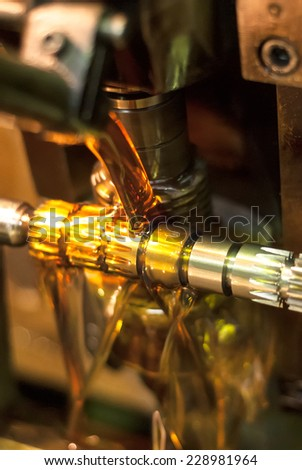 Tyumen, Russia - November 14, 2007: JSC Tyumenskie Motorostroiteli (Plant on production and repair of aviation engines). Oil chilling of detail when machining - stock photo
