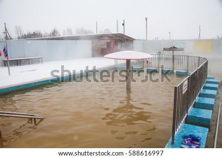 Tyumen, Russia - November 05.2016: People in pool with hot mineral water in winter, a thermal source ' Soviet '