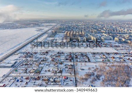 Tyumen, Russia - November 17, 2015: Residential district on Fedyuninskaya street from air. Bypass road on city boundary