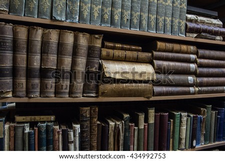 TYUMEN, RUSSIA. NOVEMBER 21, 2015. Vintage books on the shelves in a university library.