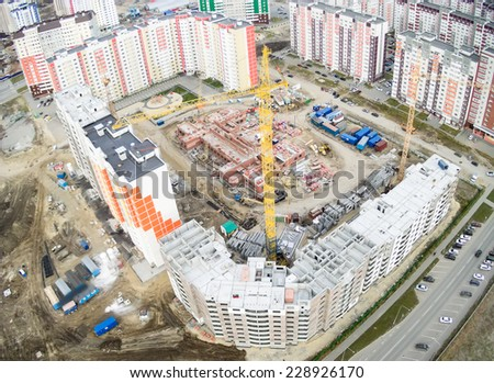 Tyumen, Russia - September 26, 2014: Aerial view on lifting cranes on residental house construction site, Nikolai Semenov street - stock photo