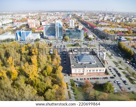 Tyumen, Russia - September 29, 2014: Bird's eye view on office buildings on Respubliki and Melnikayte streets crossroad - stock photo