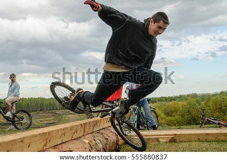 Tyumen, Russia - September 16, 2007: Second festival of cyclists Samogon in Silkin Log. Cyclist jump through log as a sports stage and falls