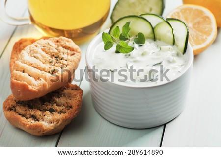 Tzatziki or cacik, cucumber, yogurt and lemon salad with fresh oregano - stock photo