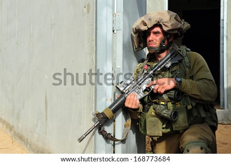 TZEELIM - MARCH 31: Israeli soldier during Urban Warfare Exercise on March 31 2011 in Tzeelim, Israel. The complexity of the terrain and civilians makes it very difficult to identify the enemy - stock photo