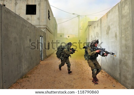 TZEELIM - MARCH 31: Israeli soldiers during Urban Warfare Exercise on March 31 2011 in Tzeelim, Israel.The complexity of the terrain and civilians makes it very difficult to identify the enemy - stock photo