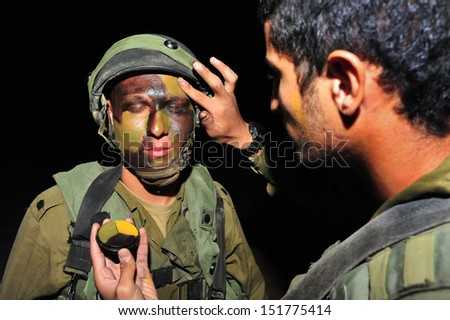 TZEELIM - NOV 09:Israeli special forces put face paint on March 31 2011.Since the beginning of history camouflage used to protect military equipment as well as individual soldiers and their positions. - stock photo