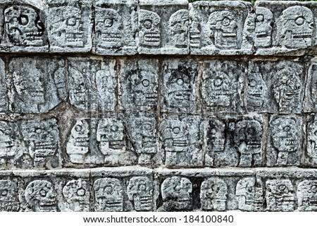 Tzompantli - Wall of Skulls, Chichen Itza, Mexico - stock photo