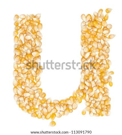 u,Alphabet from Organic corn beans dry on white - stock photo