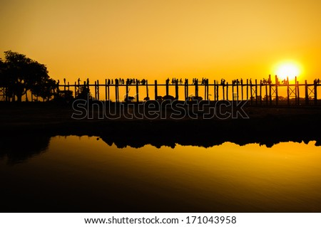 U Bein's Bridge, the world's longest teak footbridge in Mandalay, Myanmar - stock photo