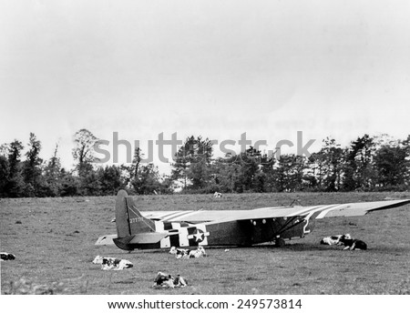 U. S. Air Force Glider that landed intact in Normandy on D-Day, June 6, 1944. The abandoned glider remained in the cow pasture after Airborne troops left for their missions. - stock photo