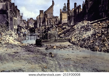 U.S. Army Engineers begin the clean up of Cherbourg after the German surrender on June 26, 1944. Normandy Campaign, France, World War 2. B&W Photo with oil color. - stock photo