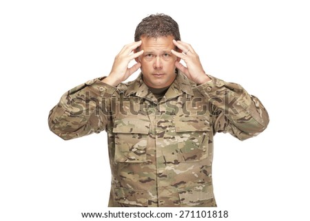 U.S. Army Soldier, Sergeant. Isolated and looking at the camera showing signs of stress or PTSD. - stock photo