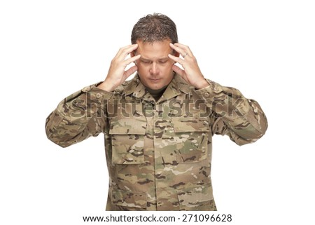 U.S. Army Soldier, Sergeant. Isolated and showing signs of stress. - stock photo