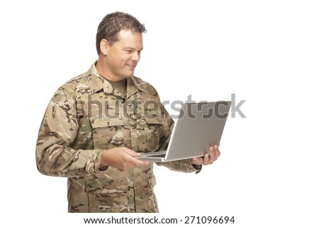 U.S. Army Soldier, Sergeant. Isolated and smiling at computer laptop. - stock photo