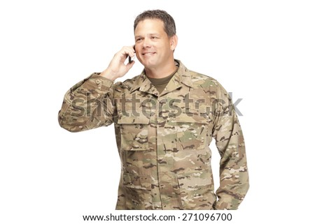 U.S. Army Soldier, Sergeant. Isolated with cell phone and smile. - stock photo