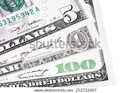 U.S. $ dollar money stacked, isolated on white.