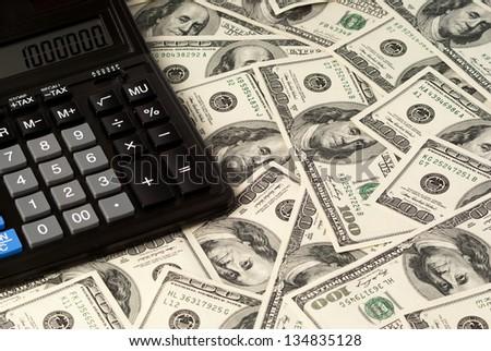 U. S. Dollars and calculator. Studio shot. - stock photo