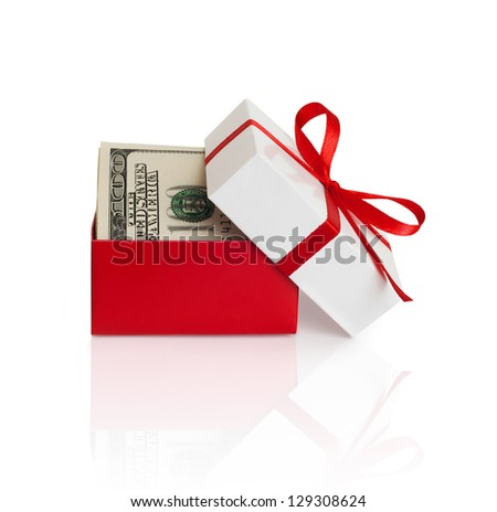 U.S. dollars banknotes laying in red bow decorated gift box.