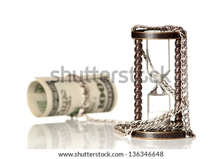 U.S.Dollars chained with hourglass with silver chain. White background. Studio shot. - stock photo