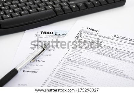 U.S. income tax form with pen and keyboard