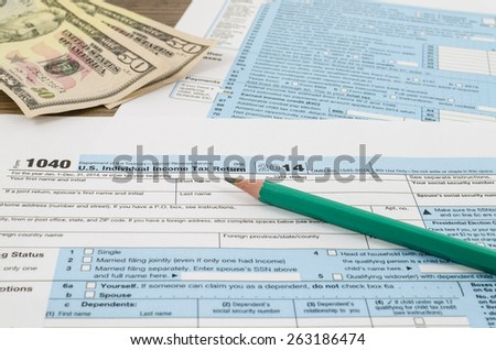 U.S. individual income tax return form 1040 with pencil - stock photo